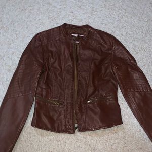Brown xhiliration size medium leather jacket